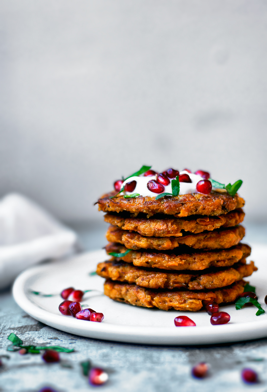 Vegan sweet potato pancakes, or latkes, with chickpea flour and plenty of spice. These are gluten free, so easy, and perfectly crisp. Potato pancakes are one of the easiest things to make, not any more difficult than regular pancakes, and a great speedy meal for any time of day.