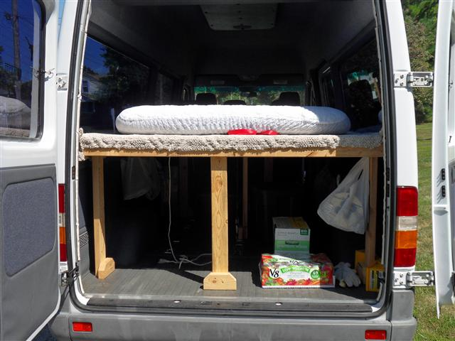 my husband made a bed platform for the back of our van that has really come in handy for camping and sometimes on road trips he made it high enough for