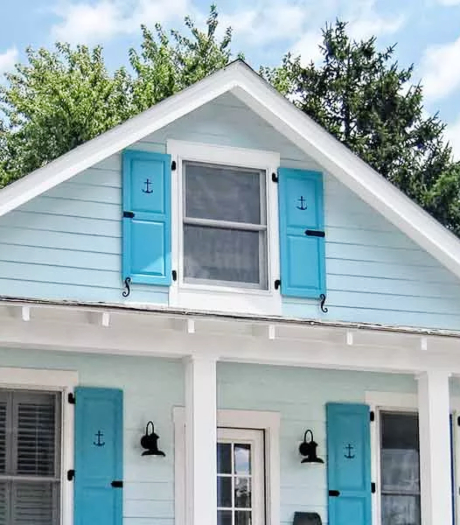Cottage Curb Appeal Makeover with Blue Nautical Anchor Shutters