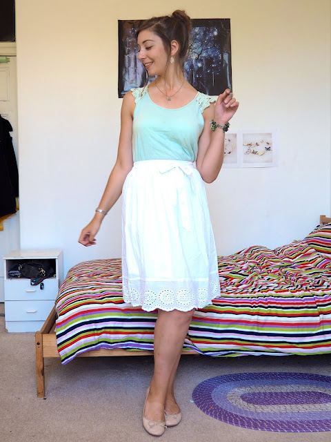 Princess Tiana Disneybound outfit of pale green lace top, long white skirt, nude flats and nature themed jewellery