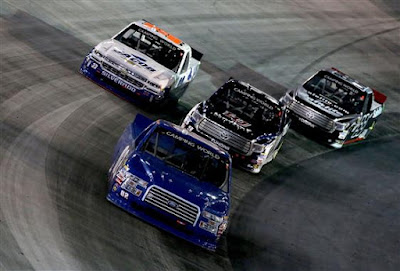 Austin Hill, driver of the #02 Ford, leads a group of cars during the race.