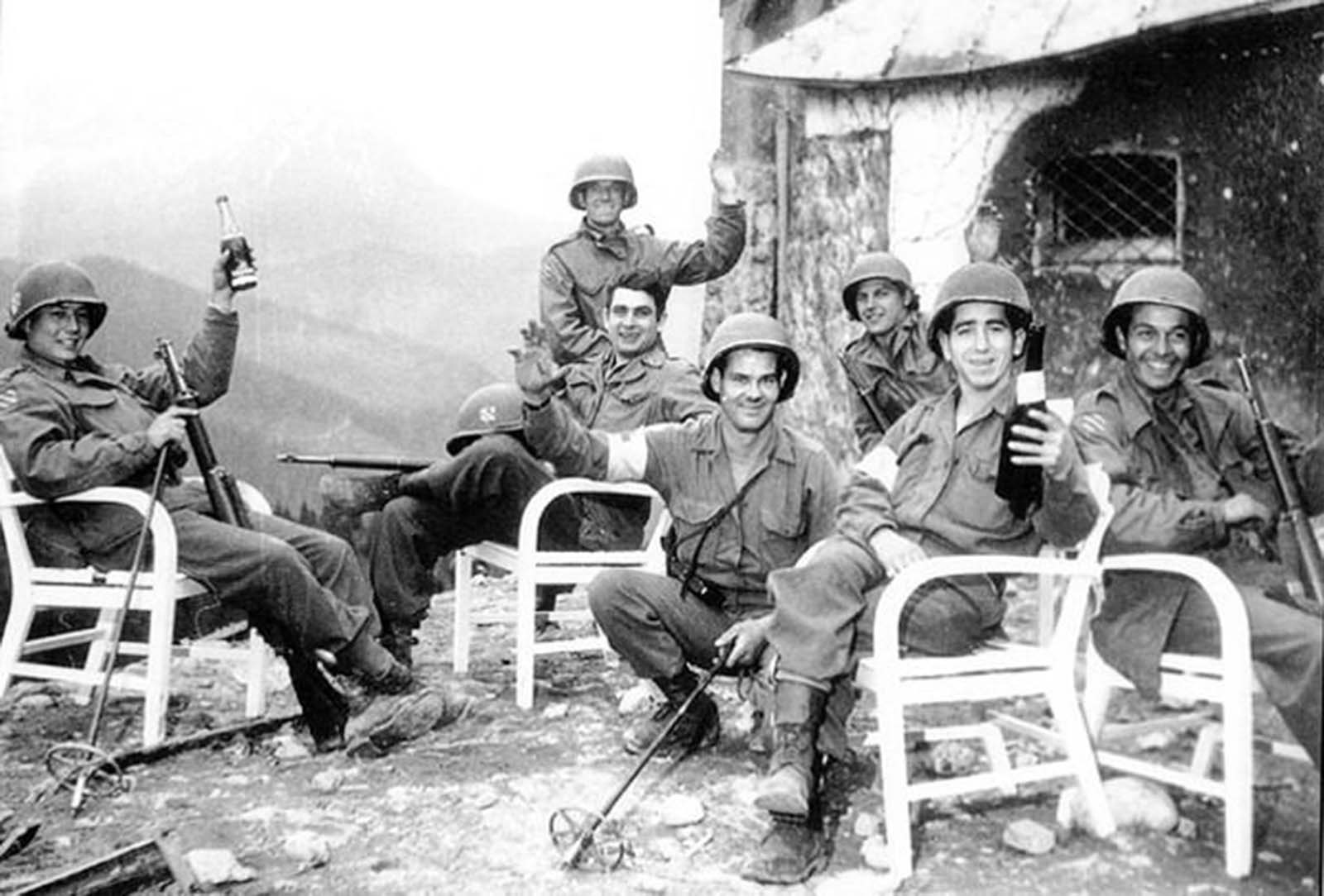 The 7th Infantry Regiment attached to the 3rd Infantry Division drink Hitler's wine on the patio of the Berghof, below the Eagle's Nest.