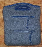 http://www.ravelry.com/patterns/library/charcoal-denise-needle-bag-with-two-pockets