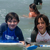 Two boys boogie boarding at Paradise Cove