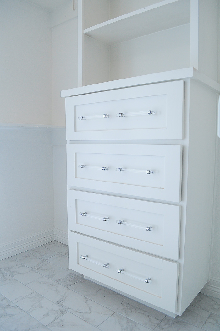 White shaker cabinets with lucite pulls. | via monicawantsit.com