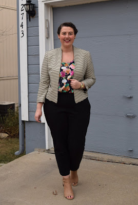 an outfit with a floral blouse, striped jacket, black trousers, and nude booties
