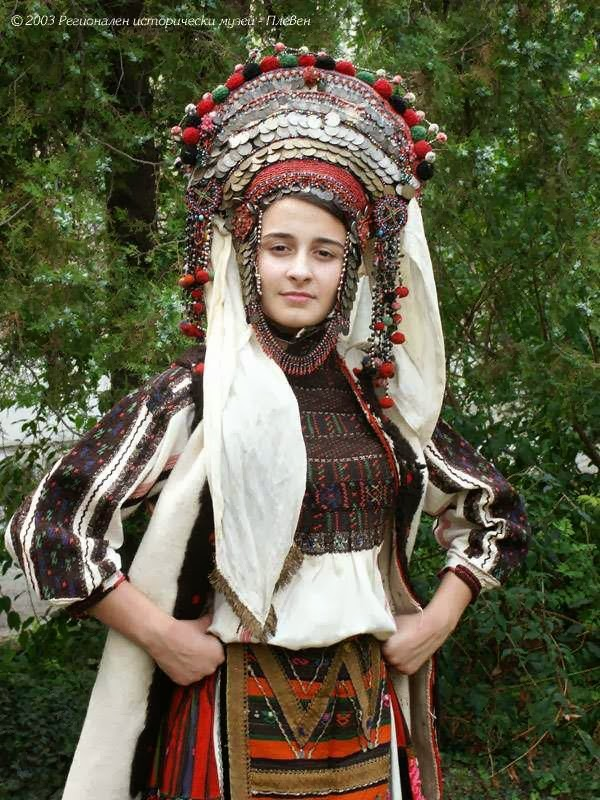 Local style: Traditional wedding costume and headdress of ...