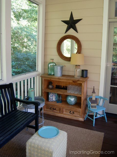 Bookcase cut in half now serves as small sideboard and creates a beverage serving station on screened porch.