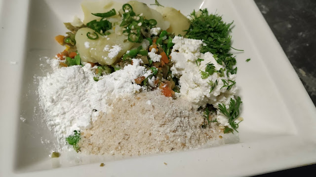 Chopped chilly Coriander leaves bread crumbs paneer and Corn flour mixture food recipe