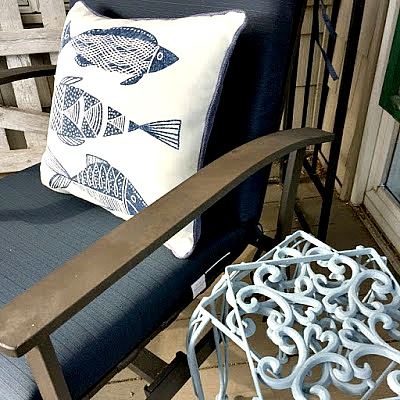 Metal deck furniture with blue cushions