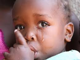 small black african girl crying while her finger in her mouth