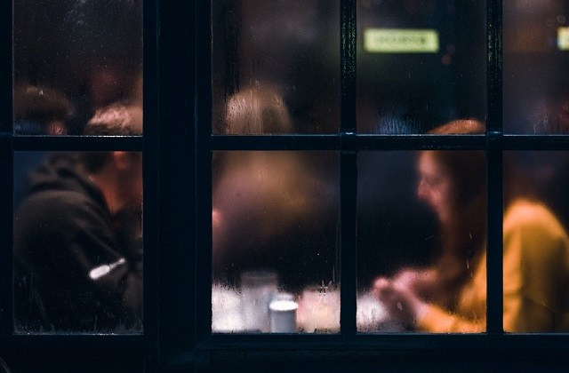 man woman restaurant window