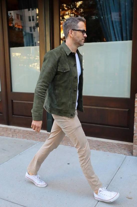 dark green shirt with khaki pants