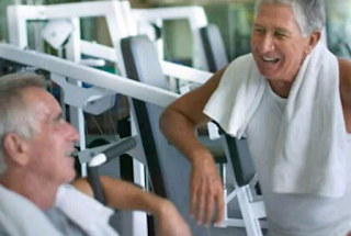 Two old men chatting in the gym