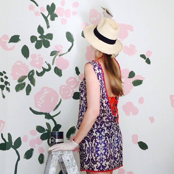 Artist and stylemaker Kate Schelter painting floral mural with Farrow and Ball