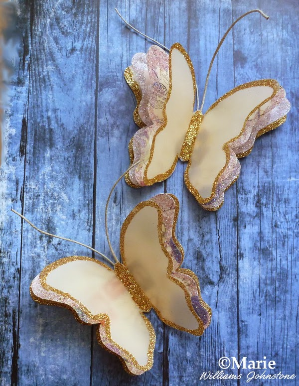 3D Layered Paper and Vellum Butterflies edged with glitter. Great as handmade card and scrapbook embellishments as well as party decorations
