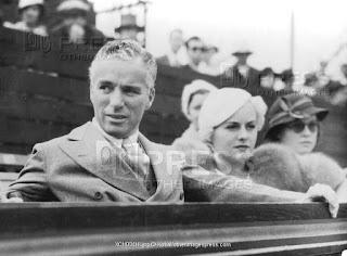 Чарли Чаплин и Полетт Годдар на теннисном турнире (август 1932) 2