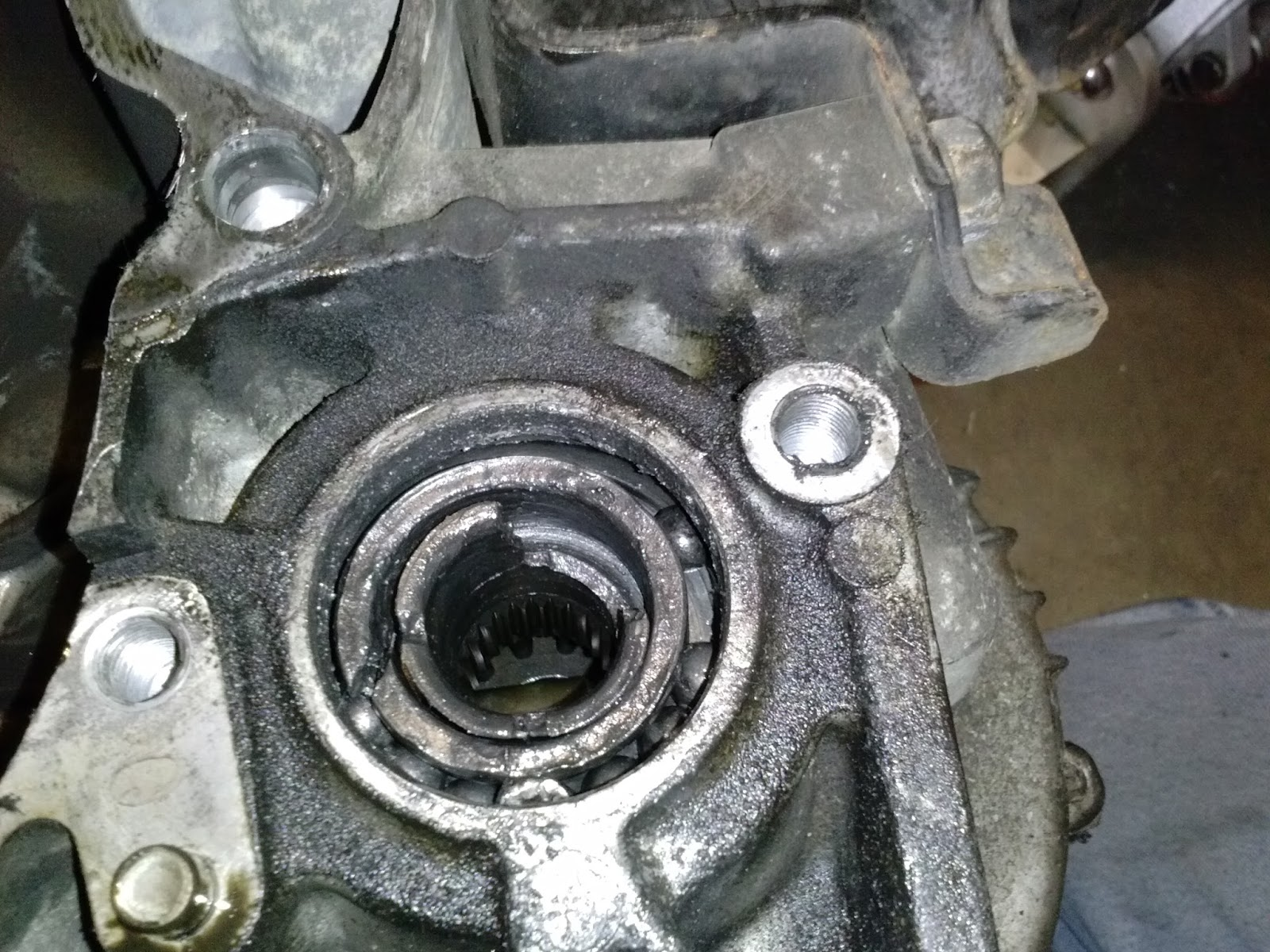 After I got the transmission out, I saw the reason the seal was dislodged.  The output bearing on the front differential was destroyed.