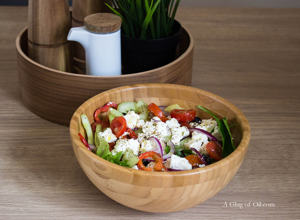 Greek Salad with Potatoes in Wooden Bowl