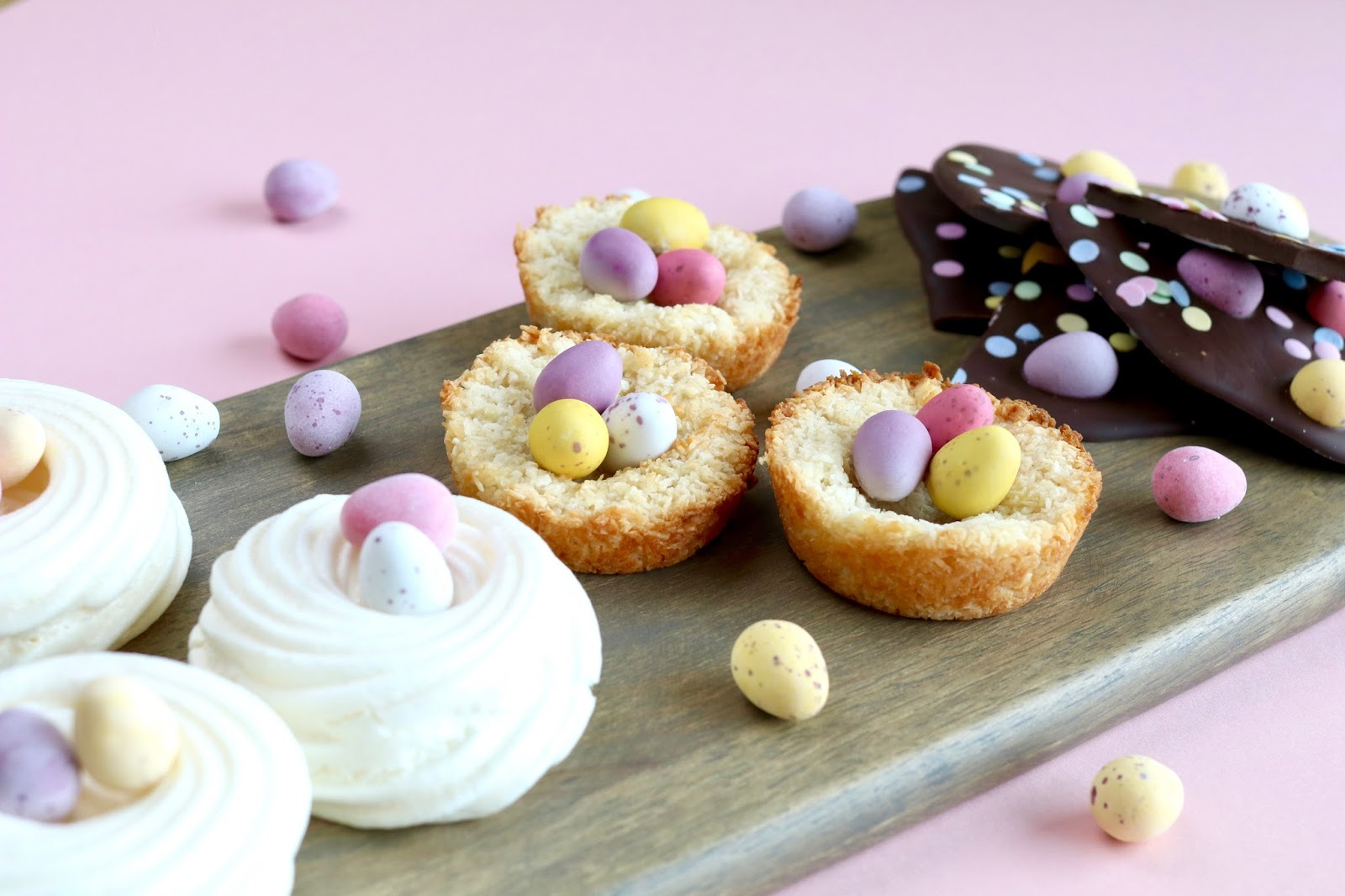 Easter treats coconut macaroons meringue nests chocolate bark with mini eggs
