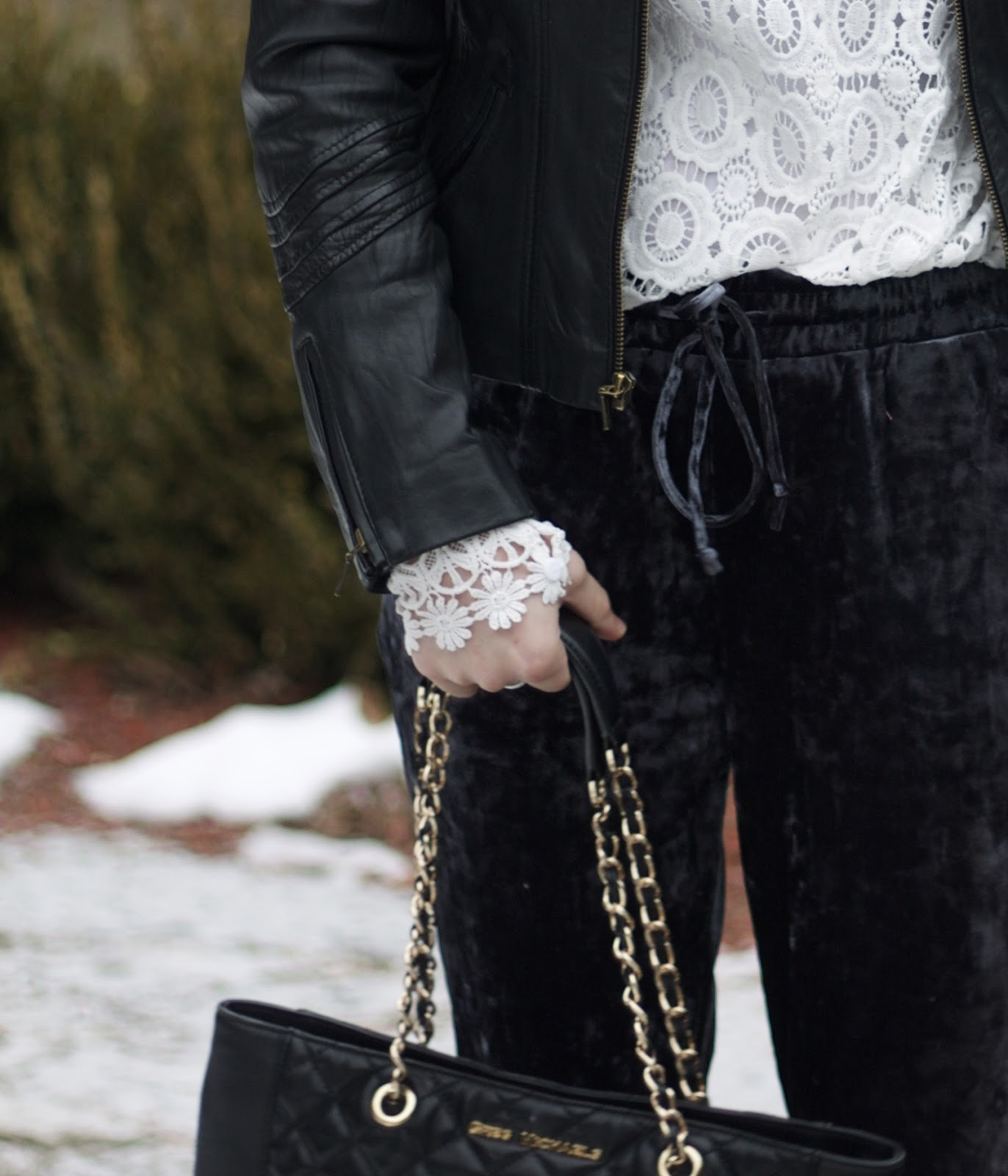 long sleeve white lace top, black moto jacket, blue velvet joggers, velvet joggers for date night