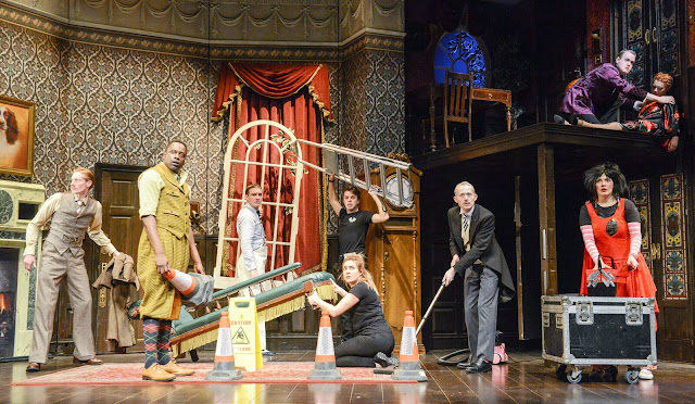 The cast setting the scene for The Play That Went Wrong