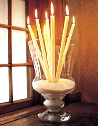 These candles in a sand vase are a fun way to brighten up any room.
