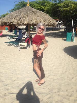 woman on sunny beach posing