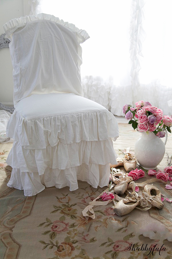 white slipcovered chair with ruffles