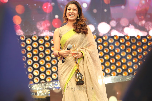Nayanthara wearing Beige colour kotta silk saree paired with raw silk, boat neck, sleeveless blouse