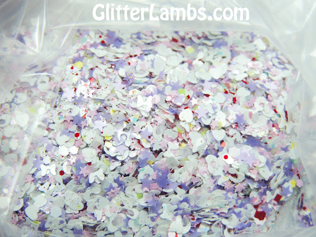 White opal iridescent hex, white bows, lavender stars, red and white hex, micro pink hex, micro iridescent glitters, pastel colored hex glitters in blues, yellows, and pink, Pink mini stars, white hearts, white leopard spot glitters, micro holographic burnt amber orange glitters.