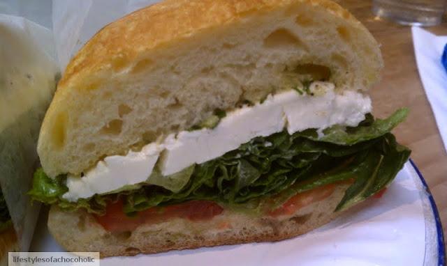 tomato basil mozzarella sandwich on a white plate