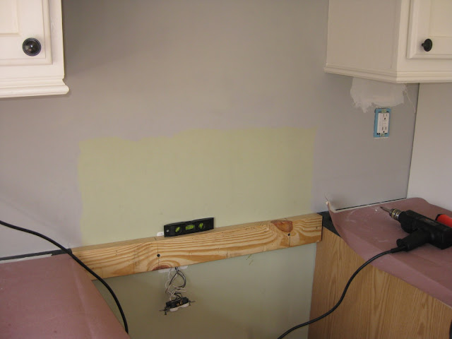 installing a temporarily support during backsplash installation