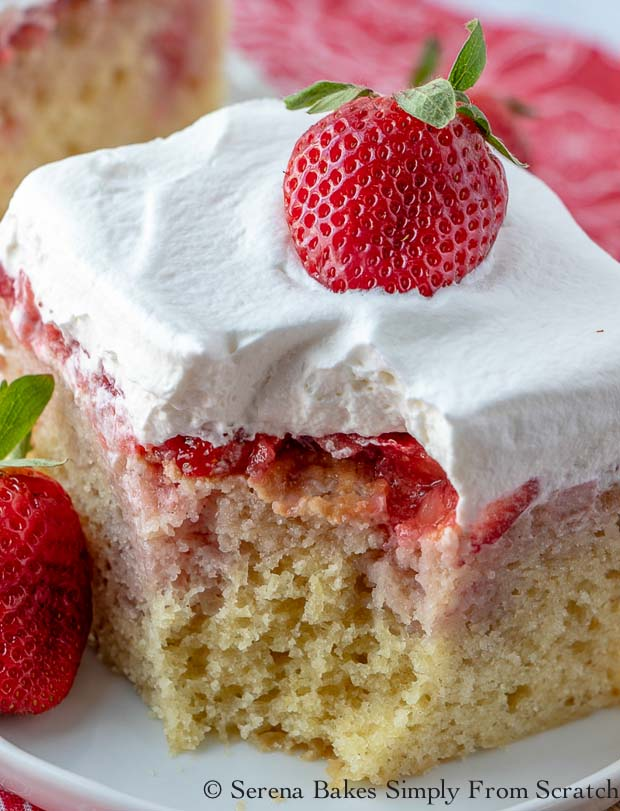 Strawberry Shortcake Poke Cake is a light lemon buttermilk yellow cake filled with pureed and chopped strawberries then covered in whip cream from Serena Bakes Simply From Scratch.