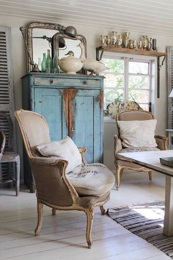 Decorating ideas and home decor: #Frenchfarmhouse living room with vintage chairs with #grainsack upholstery on Hello Lovely Studio #Frenchgrainsack