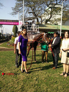 Bollywood Actress Kangana Ranaut Stills in Purple Short Dress at the Derby  0006.jpg