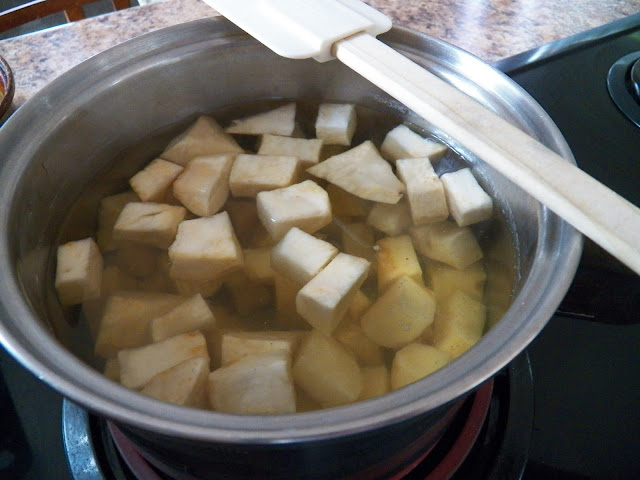 Celery root cubed and cooking in pot