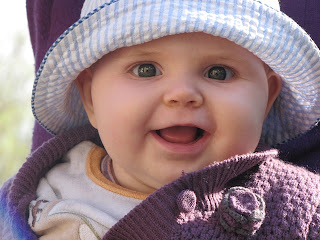 baby girl, blue hat, smiling face, by McStone