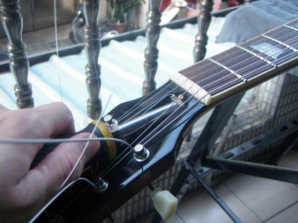 CAUTION: If you find that the truss rod is very difficult to turn, then  stop now and take your guitar to the guitar shop. It may be that there is a  problem ...
