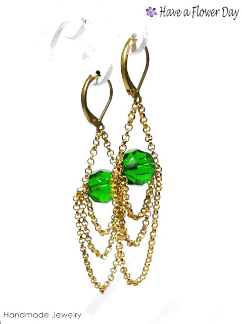 Pendientes con cristal  cadena · Earrings with crystal and chain