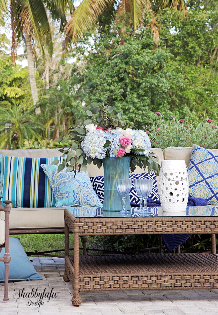 patio with blue pillows