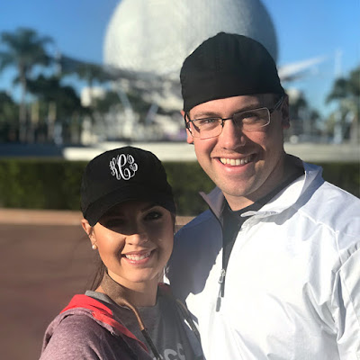 monogrammed baseball hat in front of epcot at disney