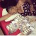 Photo: Actress Princess Pemu pose with wads of Ghanaian money