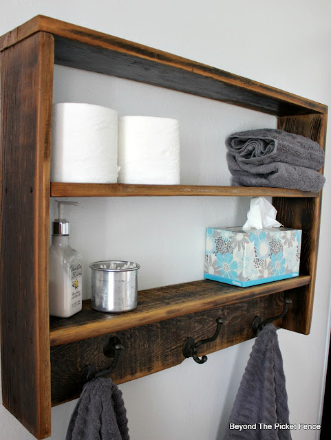 make a rustic wall shelf from old fence boards