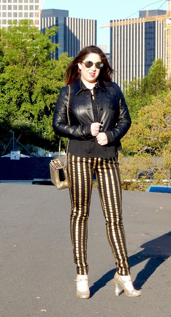 Marisa Stewart The High Heeled Breunette Fun Outfit with Cusp Moto Jacket Striped Frankie B jeans Paired Chanel Sunglasses and Miu Miu gold glitter shoes and Christian Louboutin Gold Purse