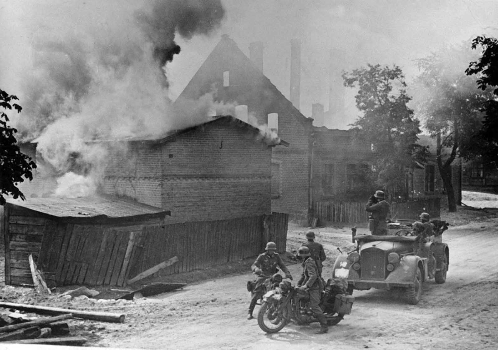 German advance guards and scouts are shown in a Polish town that has been under fire during the Nazi invasion of Poland, September 1939.