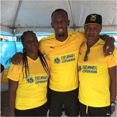 Usian Bolt shows off parents