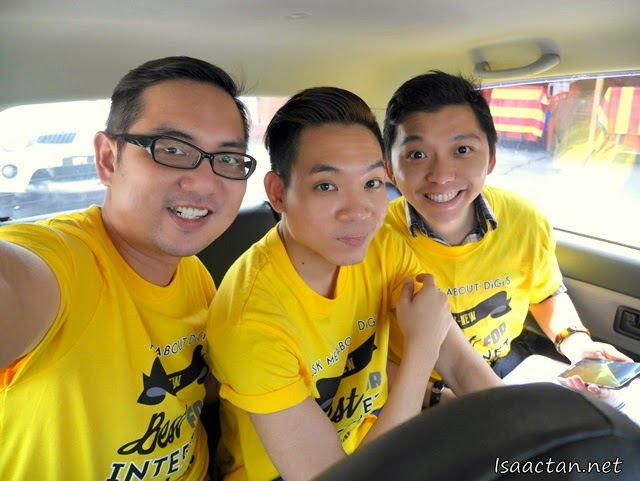 A group selfie (we-fie) in our ride, all decked in DiGi's yellow shirt and equipped with DiGi sim card