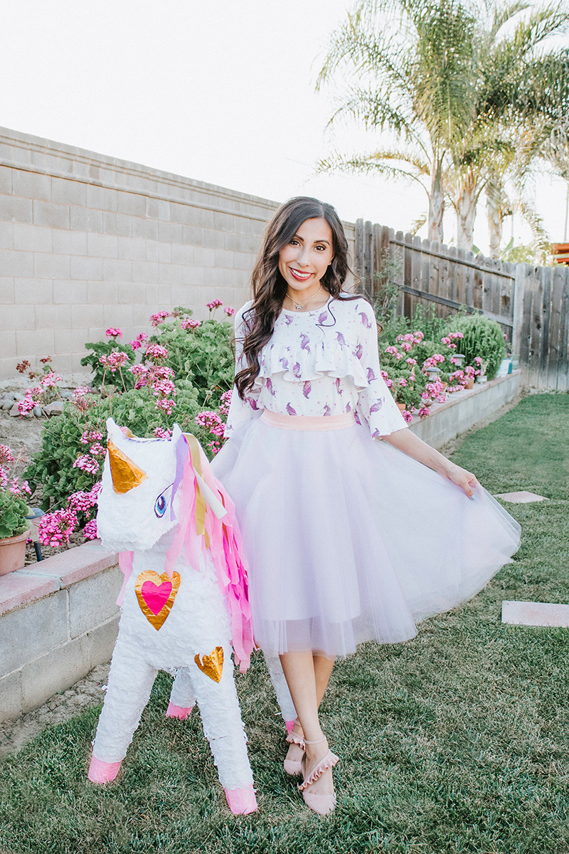 unicorn ruffle blouse with pastel tulle skirt and big unicorn pinata