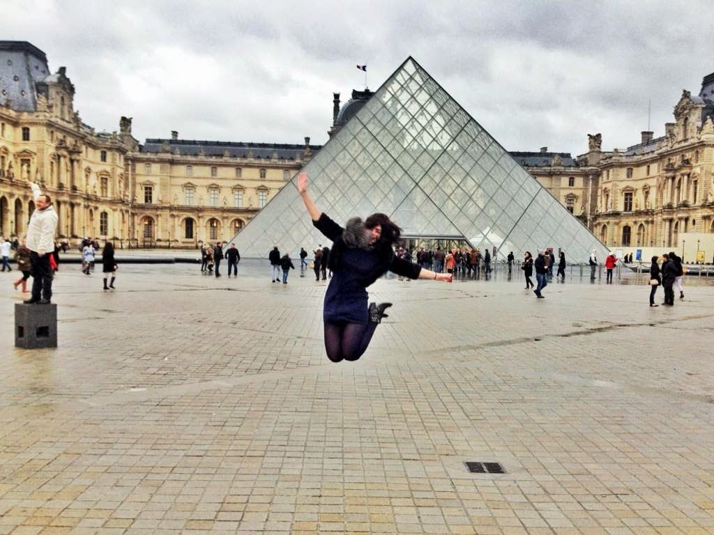 Emma Louise Layla jumping for joy at the Louvre in Paris